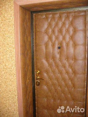 оформление входной двери кожей внутри квартиры